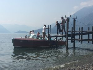 Wedding party back at one of Varenna's little stone beaches